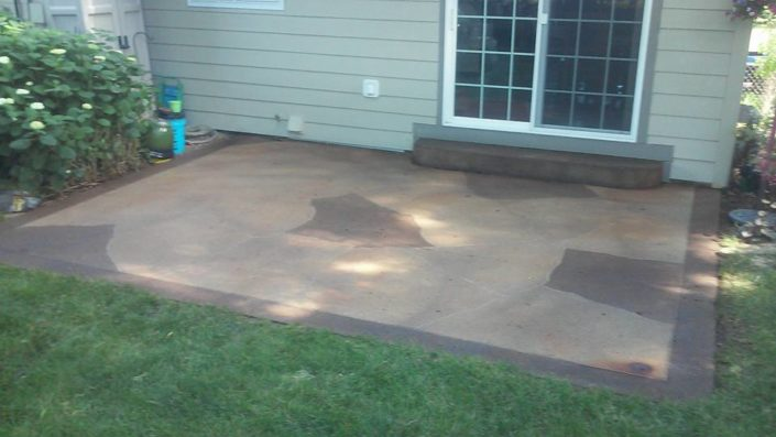 Acid stained patio with solid border and flagstone engraving